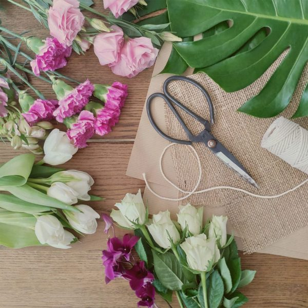 Mother's Day Posy Workshop Table with flowers, foliage, trim and tools needed to arrange a beautiful posy
